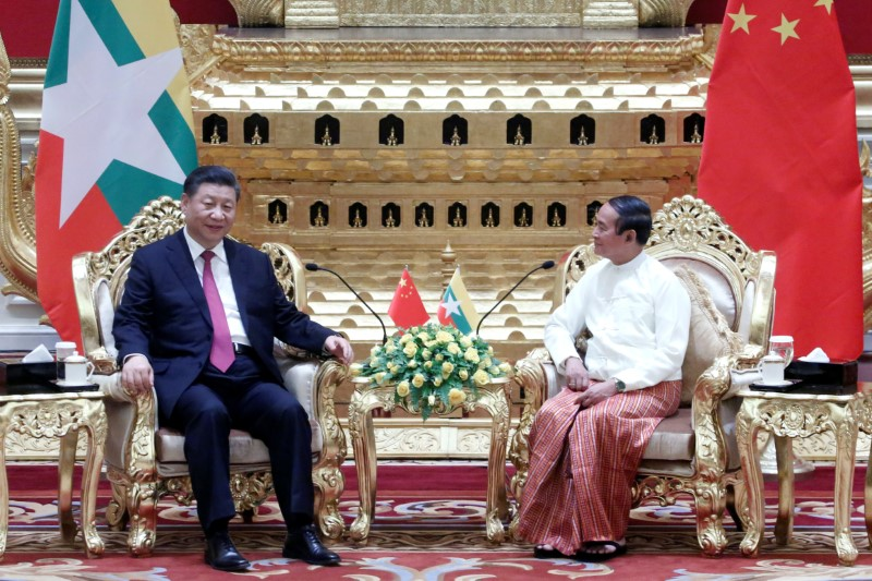 Myanmar president hails historic visit as Chinas Xi arrives to fanfare