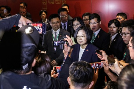 Taiwan president in U.S. after warning of threat from overseas forces