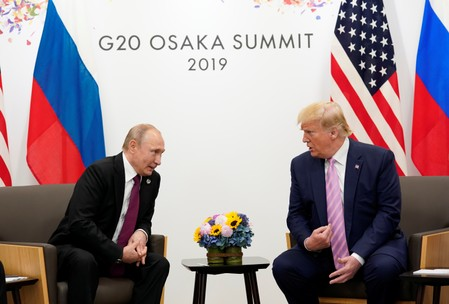 Trump, with a wag, asks Putin not to meddle in U.S. elections