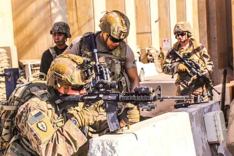 Pentagon chief denies U.S. leaving Iraq; Tehran crowds mourn commander