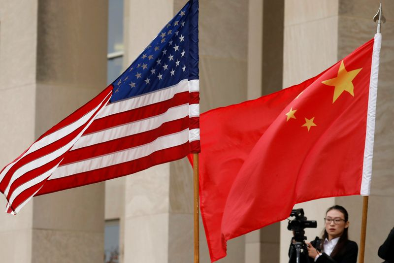 China denies report it may detain Americans, says U.S. mistreats its scholars