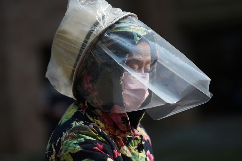 Coronavirus infects hundreds in Chinas prisons as global markets take hit