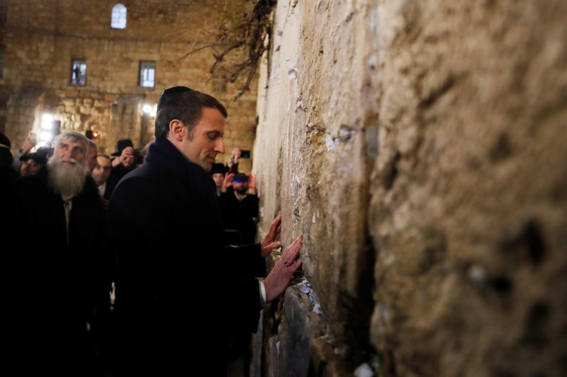 Macron, in Israel for Holocaust memorial, warns of dark shadow of anti-Semitism