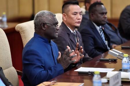 China, Solomon Islands sign deals under new diplomatic ties