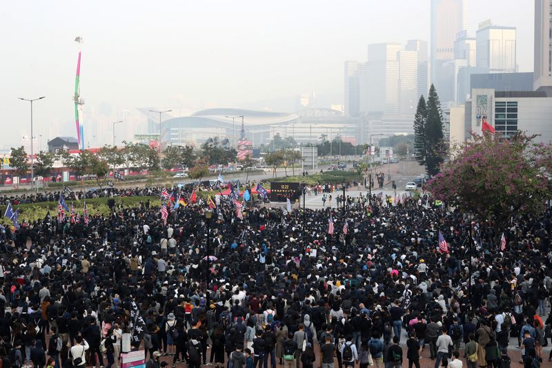 Protesters rally near Hong Kong harbor, more demos planned over Christmas