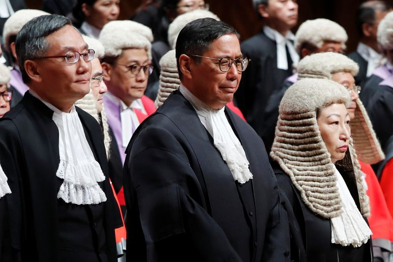 Special Report: Hong Kong judges battle Beijing over rule of law as pandemic chills protests