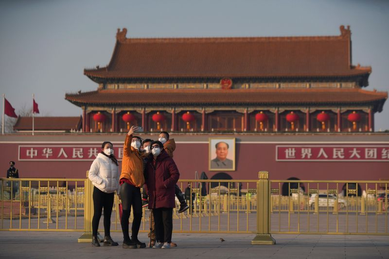 China raps mean U.S. for travel warning as virus toll reaches 213