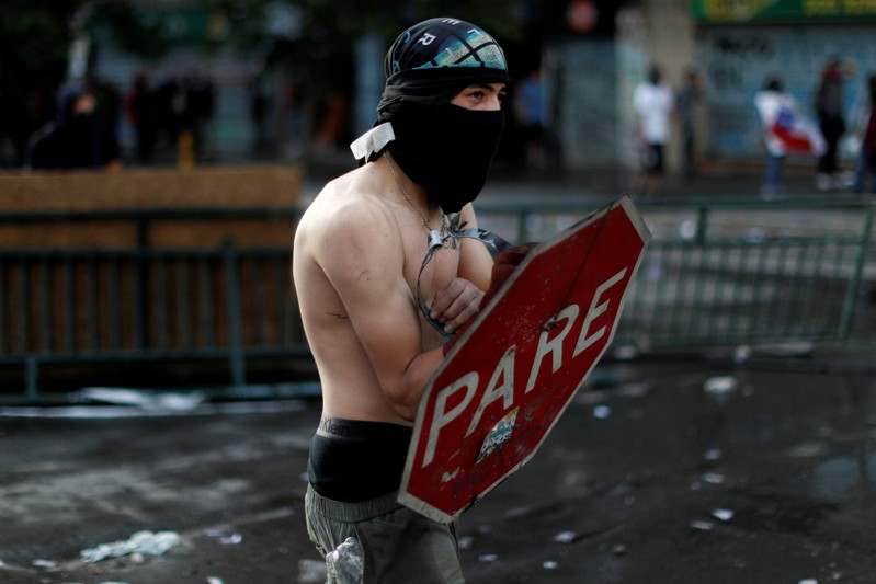Looking for a hero: shirtless Chilean protester, police-hating dog rise to fame