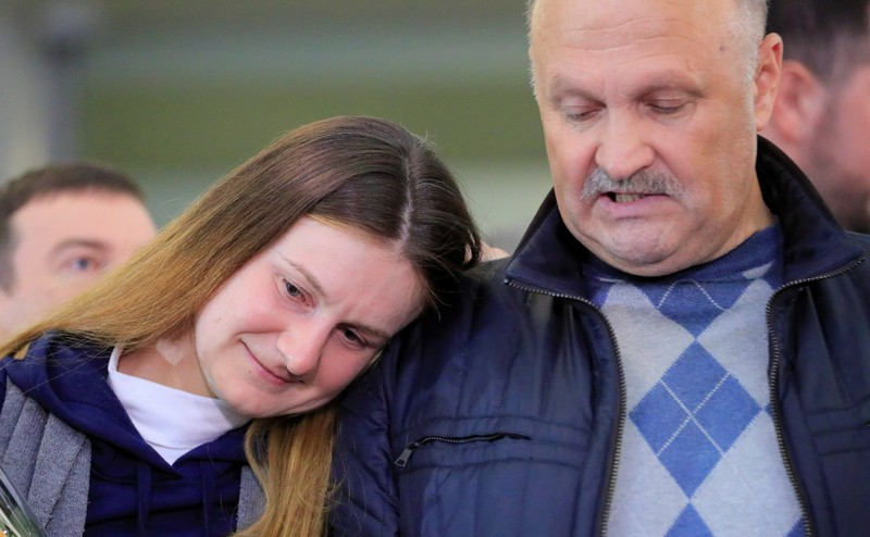 Russian woman convicted by U.S. of being agent returns home