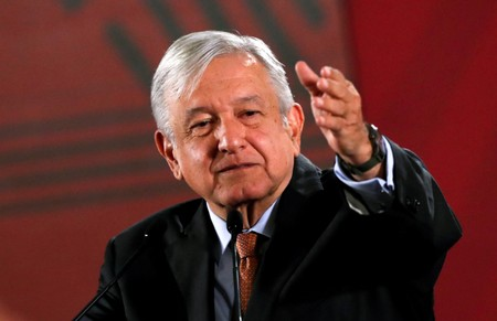 Mexican president backs official accused of suspect real estate purchases