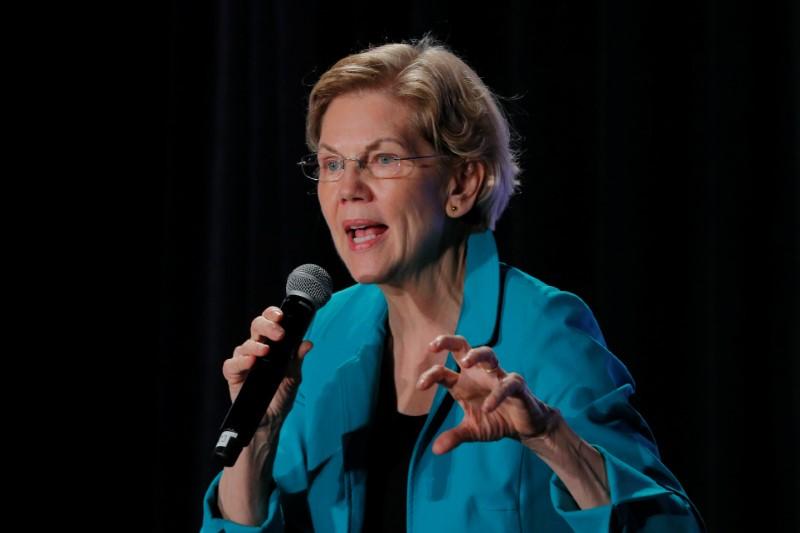 Warren calls on big U.S. banks for steps on climate risk