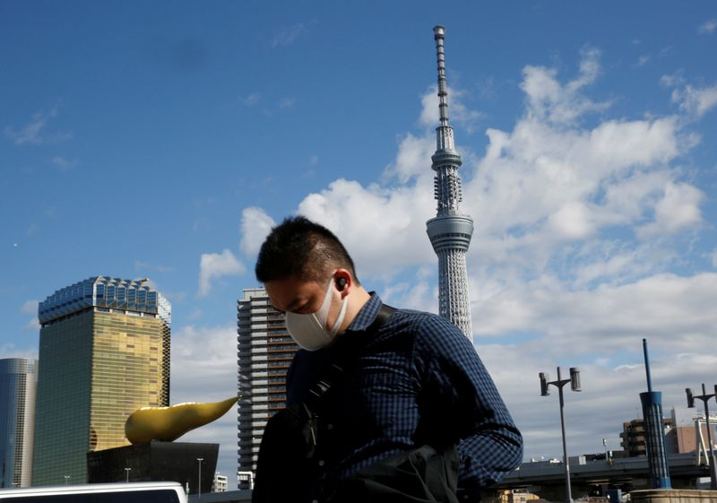 Japan seeks to contain economic impact of virus, new measures come into effect