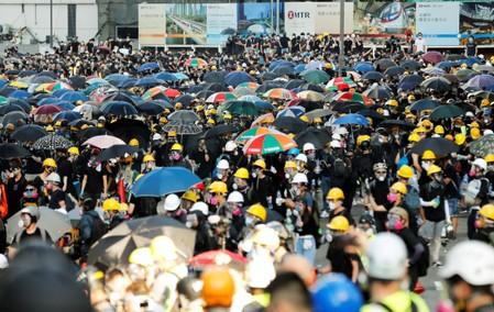 Hong Kong protests take a toll as companies flag impact