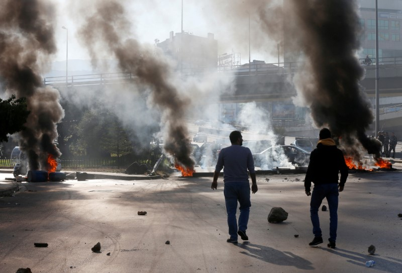 Lebanon security forces fire tear gas, clash with protesters near central bank
