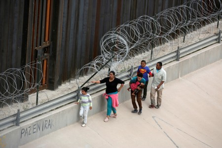 Asylum seekers anxiously cross into U.S. as new policy kicks in