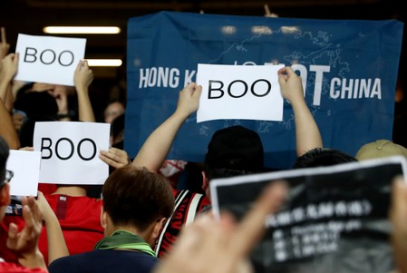 Hong Kong protesters boo Chinese anthem, as leader warns against interference