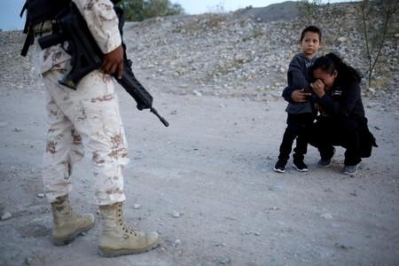 Reuters photo captures Guatemalan mother begging soldier to let her enter U.S