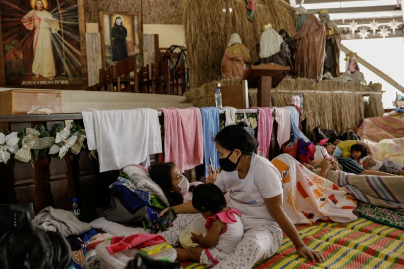 All in Gods hands: Volcano evacuees hunker down in Philippines