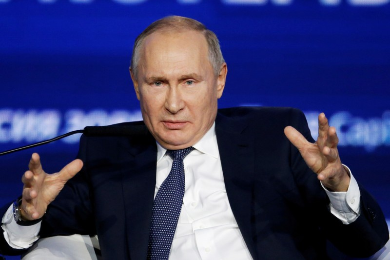 Russias Putin signs law to label people foreign agents
