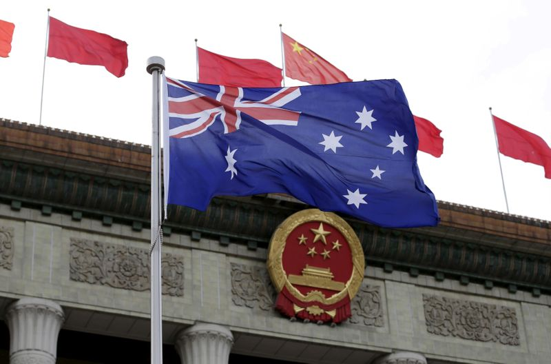 Australia says security agencies acted on evidence in Chinese journalist raid