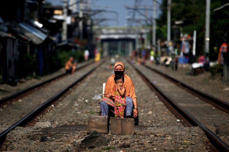 Indonesia orders coronavirus transport curbs as death toll rises