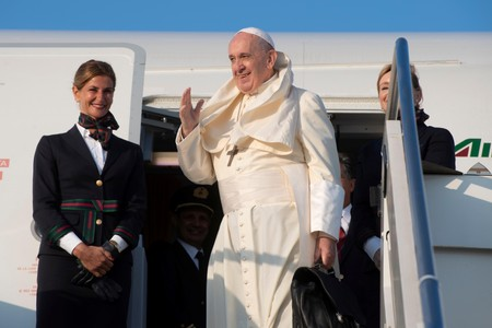 Pope calls U.S. conservative attacks an honor