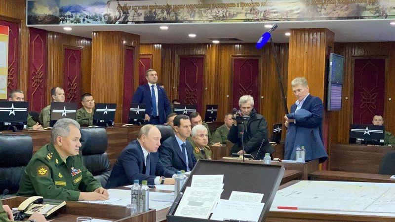 Russias Putin makes rare visit to Syria, meets Assad