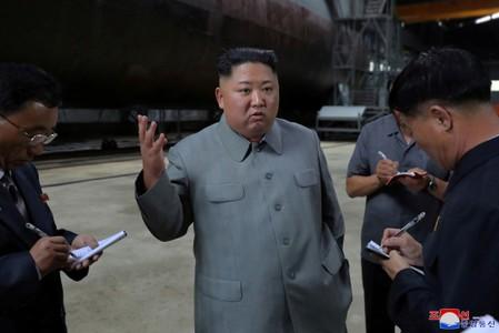 North Koreas Kim inspects new submarine, signals possible ballistic missile development