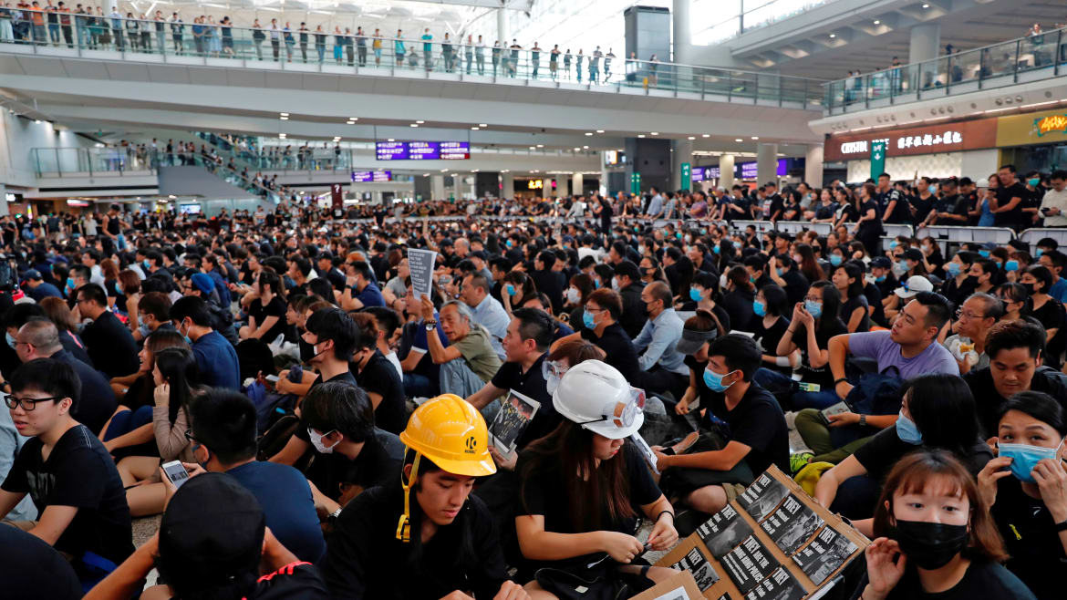 Beijing's Infowar and the Threats of Force Intensify as Protesters Shut Down Hong Kong's Airport