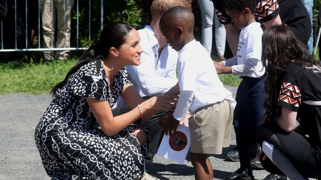 Meghan Markle Clutches Archie Harrison as They Land in South Africa