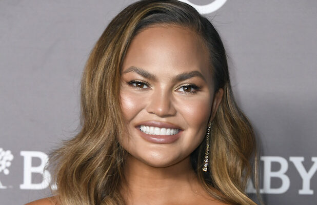 Chrissy Teigen Mocks Trump's 'MAGA Night' With $200,000 Pledge to Bail Out Protesters