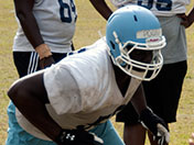 Poona Ford works hard in practice