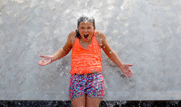 Girl cooling off during heat wave