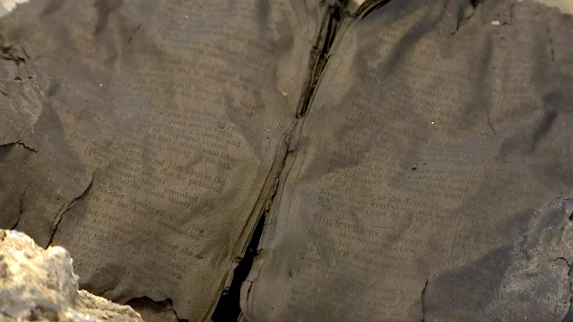 A charred bible found after the Peshtigo Fire of 1871. It was petrified from the intense heat and found opened to the pages containing Psalms 106 and 107. (AccuWeather / Blake Naftal)