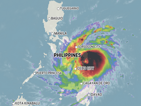 Thousands of passengers stranded on Christmas Eve as Phanfone makes landfall in the Philippines