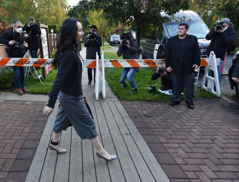 Canadian policeman describes arresting Huawei exec Meng