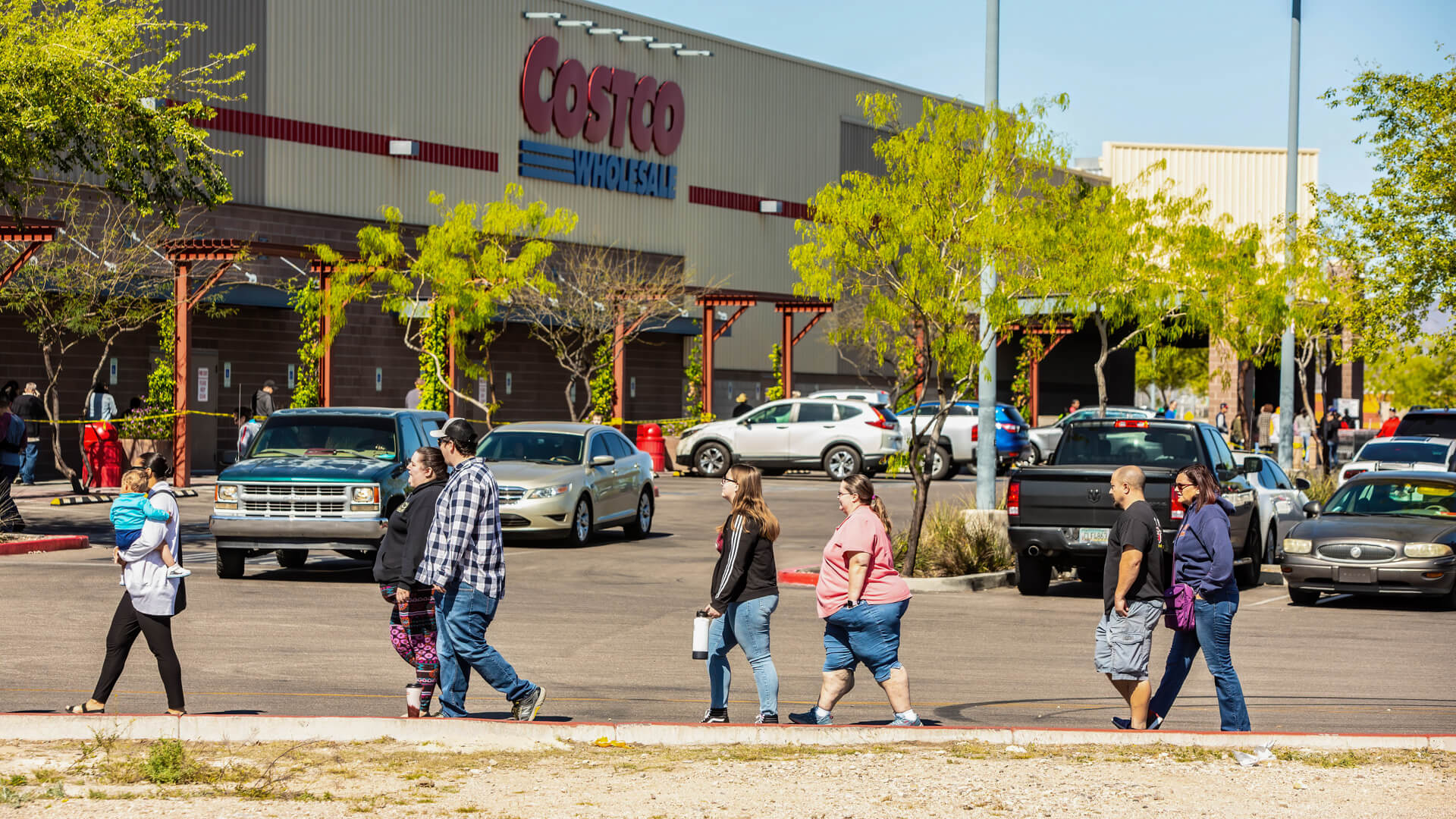 TUCSON, UNITED STATES - March 29: Shoppers practicing social distancing lined up outside Costco store in Tucson during the coronavirus pandemic.