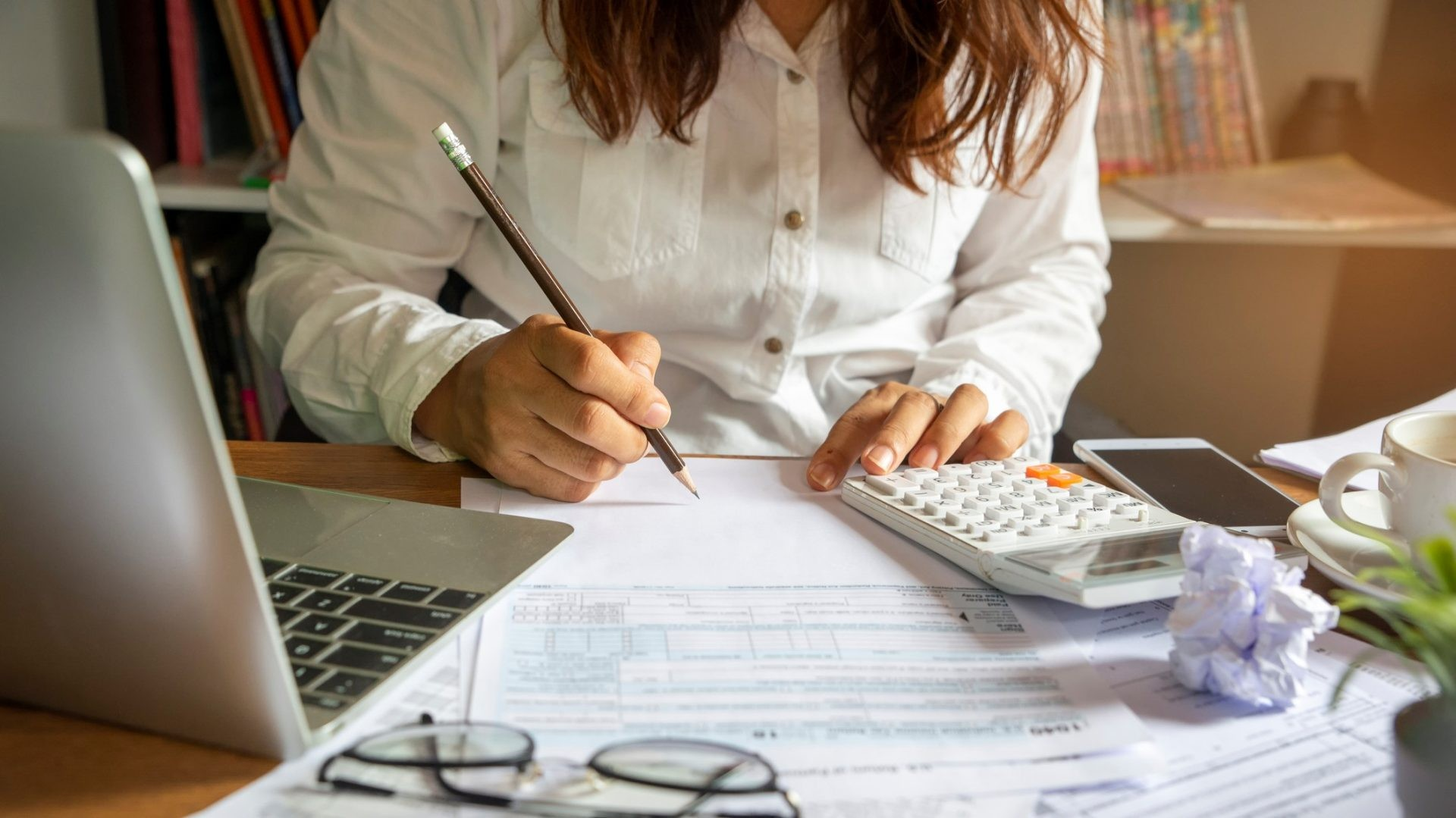Budget planning concept,Accountant is calculating company's annual tax.