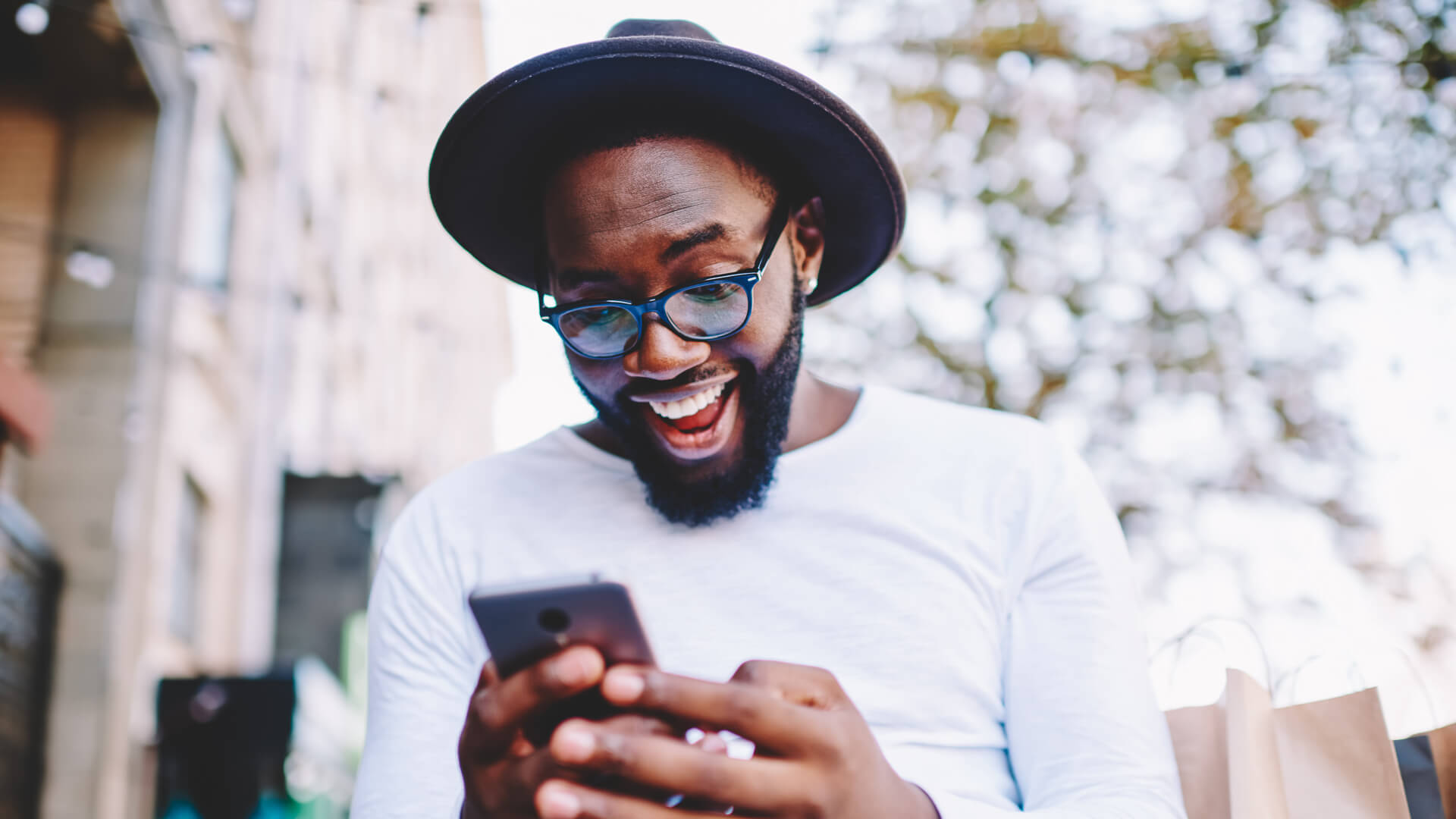 excited guy using smartphone
