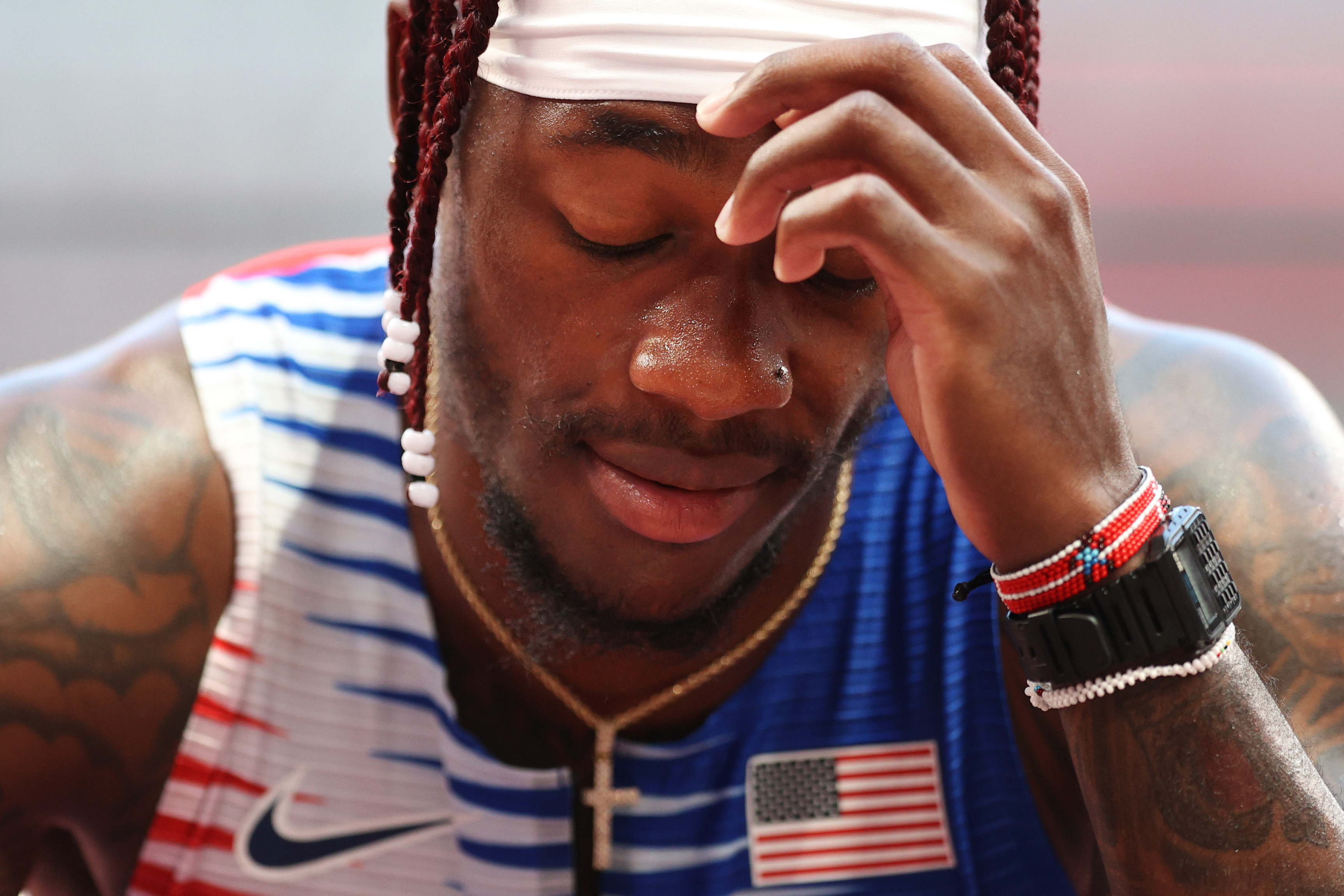 TOKYO, JAPAN - AUGUST 05: Cravon Gillespie of Team United States reacts after coming in sixth in round one of the Men's 4 x 100m Relay Heat 2 on day thirteen of the Tokyo 2020 Olympic Games at Olympic Stadium on August 05, 2021 in Tokyo, Japan. (Photo by Patrick Smith/Getty Images)