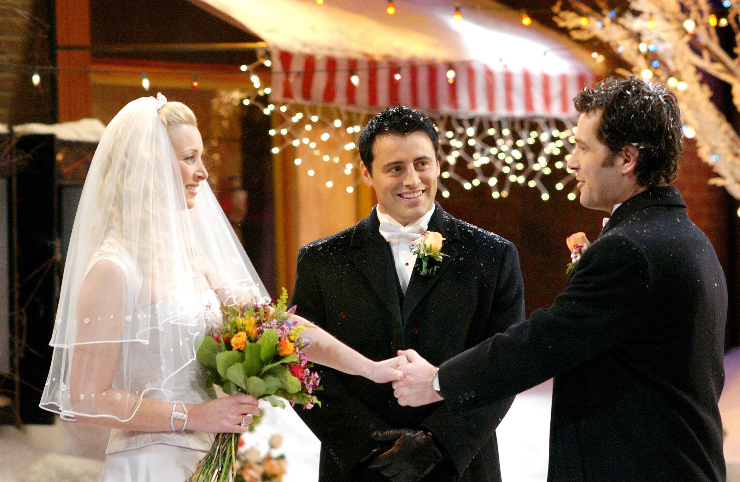Phoebe (Lisa Kudrow) weds Mike (Paul Rudd) while Joey (Matt LeBlanc) officiates in a Season 10 episode of 'Friends' (Photo: Warner Bros. / Courtesy: Everett Collection)