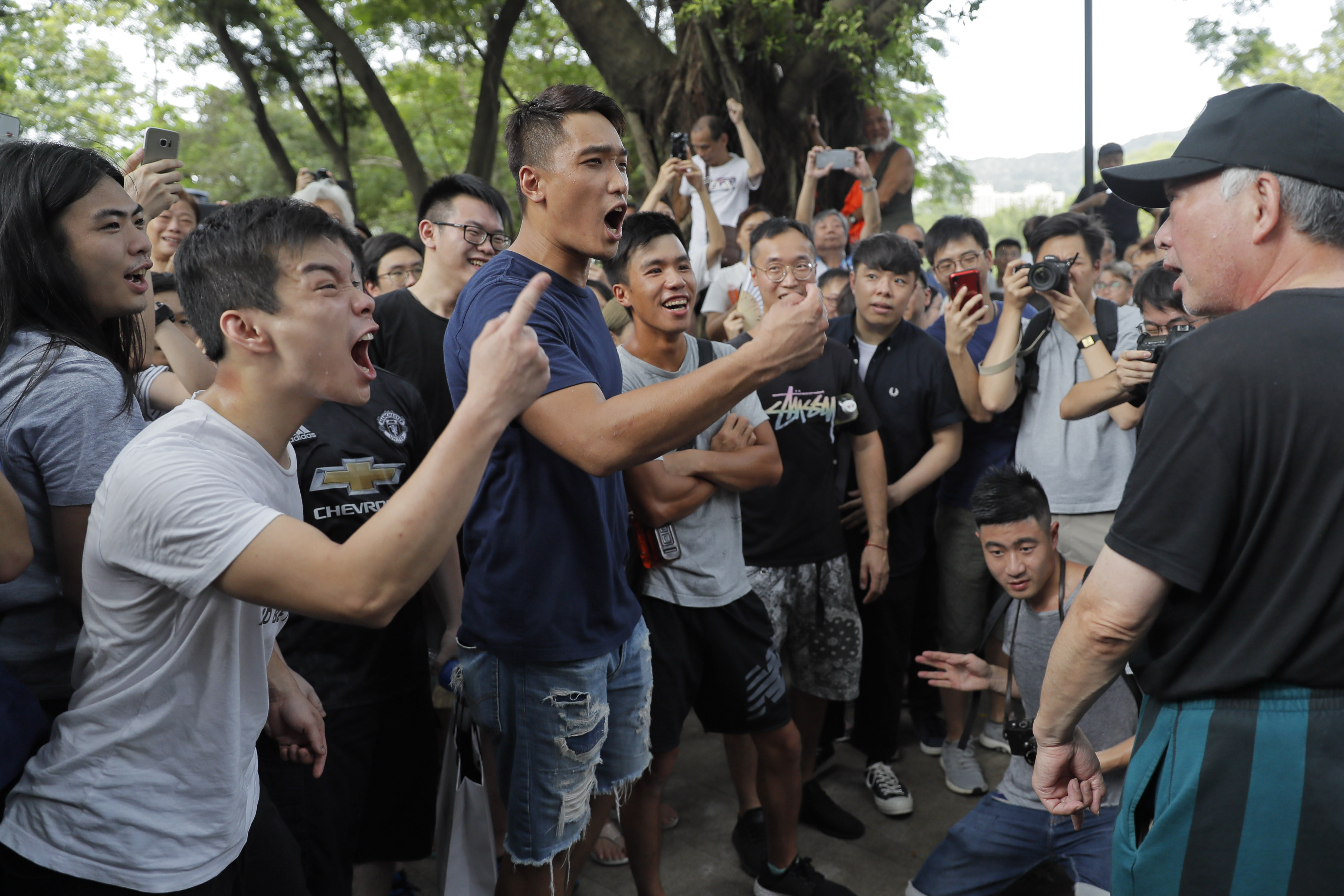 Hong Kong protesters hold vigil ahead of Sunday march