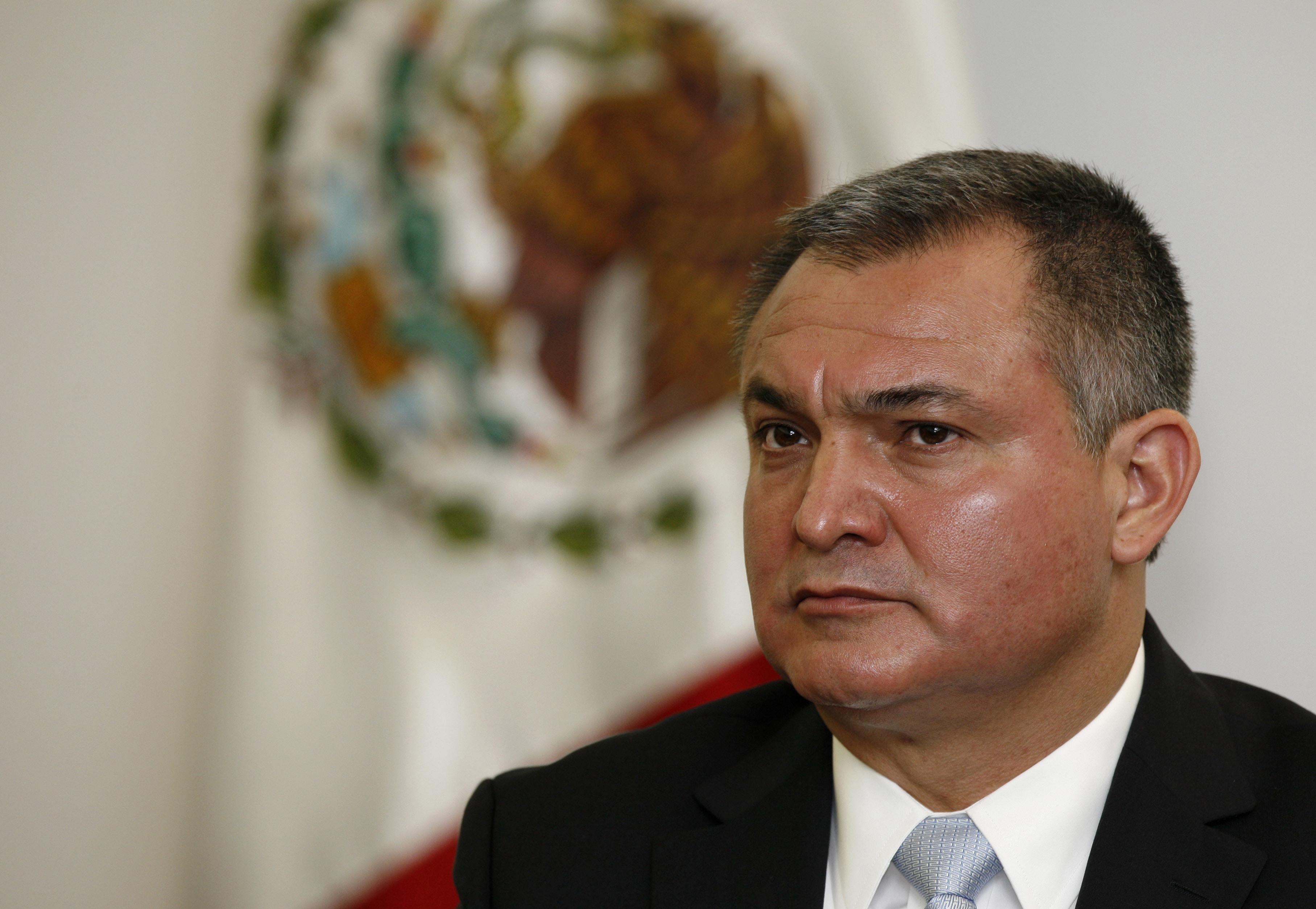 Mexico former top cop in NY plea talks over drug bribe case