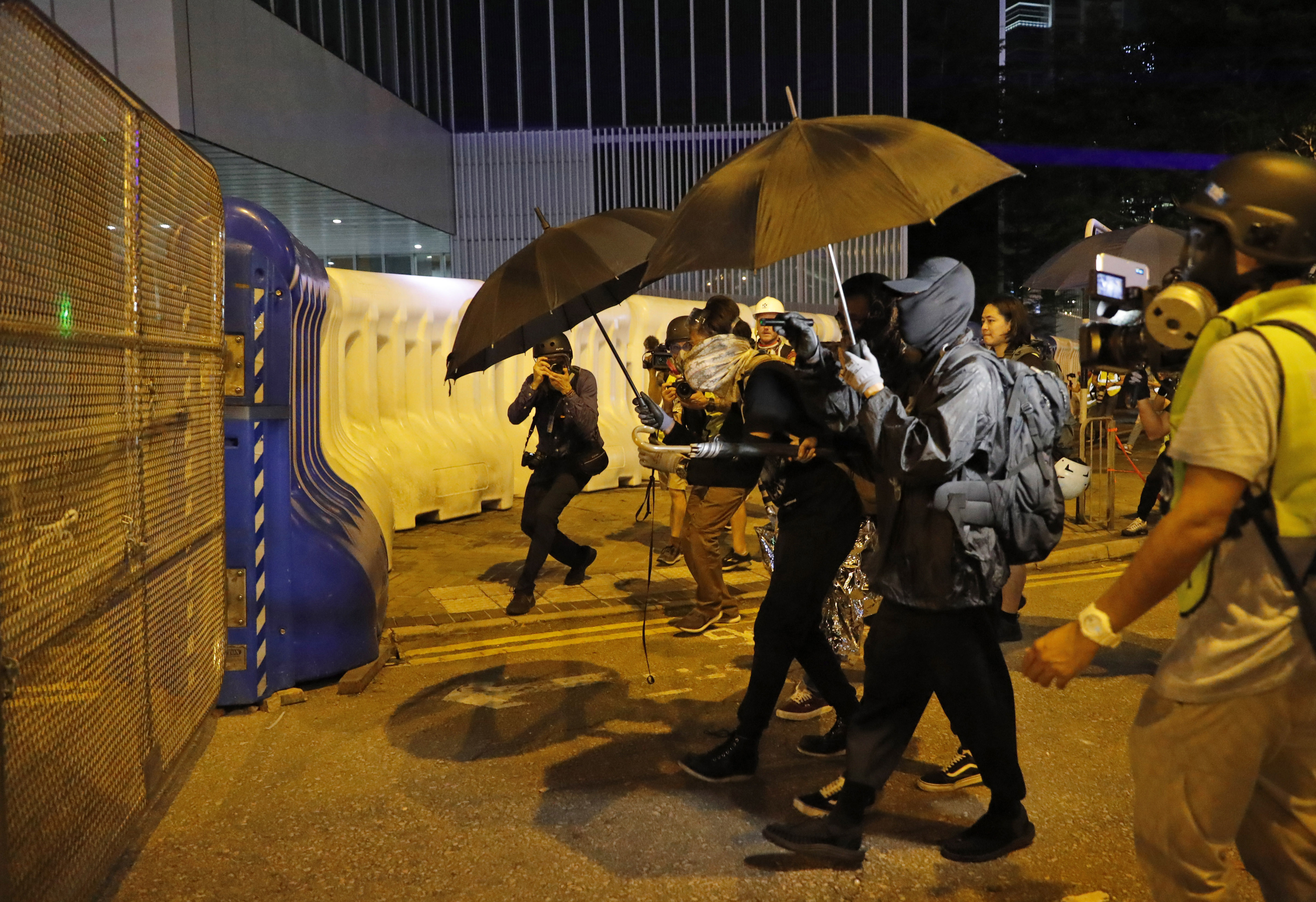 The Latest: Hong Kong rally ends early amid violence