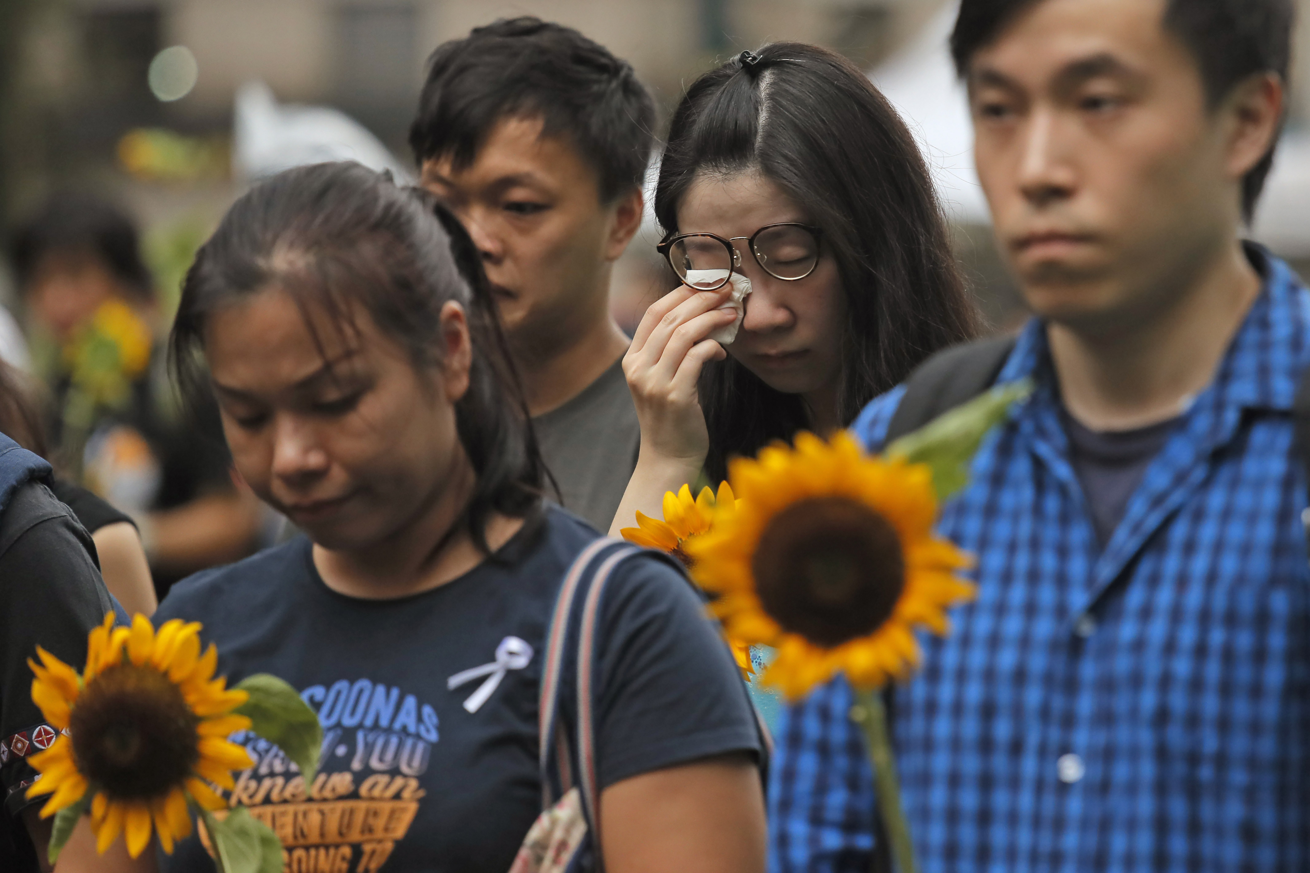 Parents of dead Hong Kong protester urge others to carry on