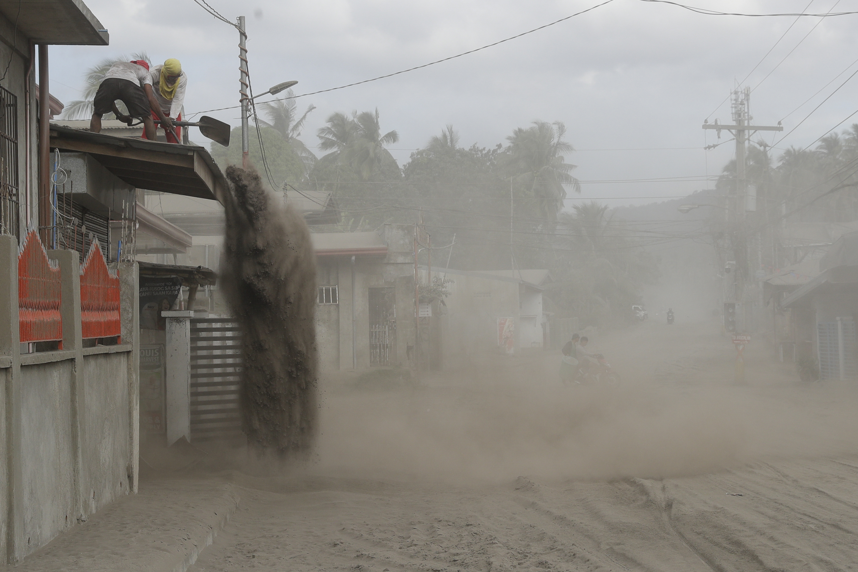 Philippine volcano simmers, officials brace for long crisis
