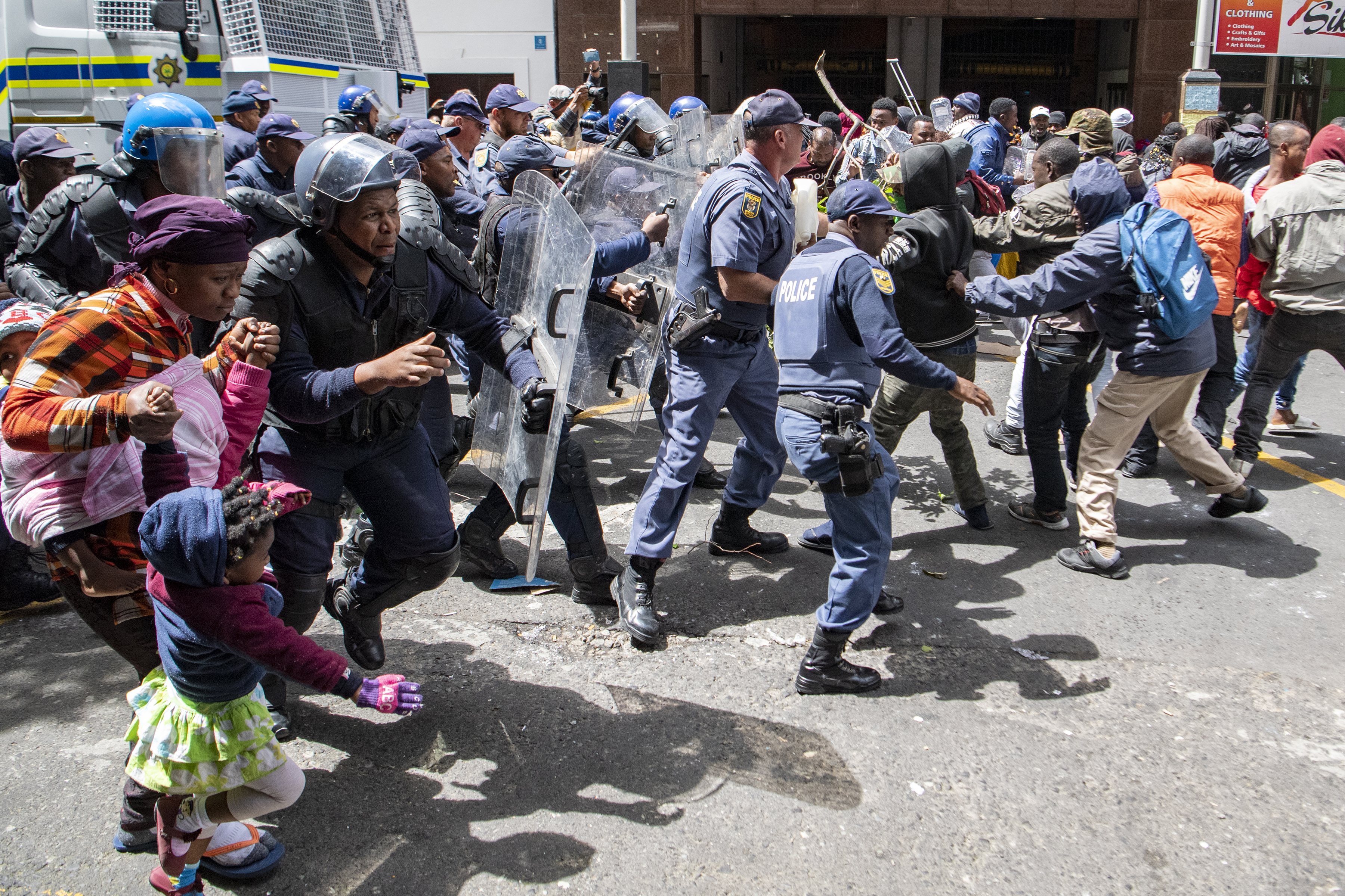 South African police arrest foreigners protesting at UN site