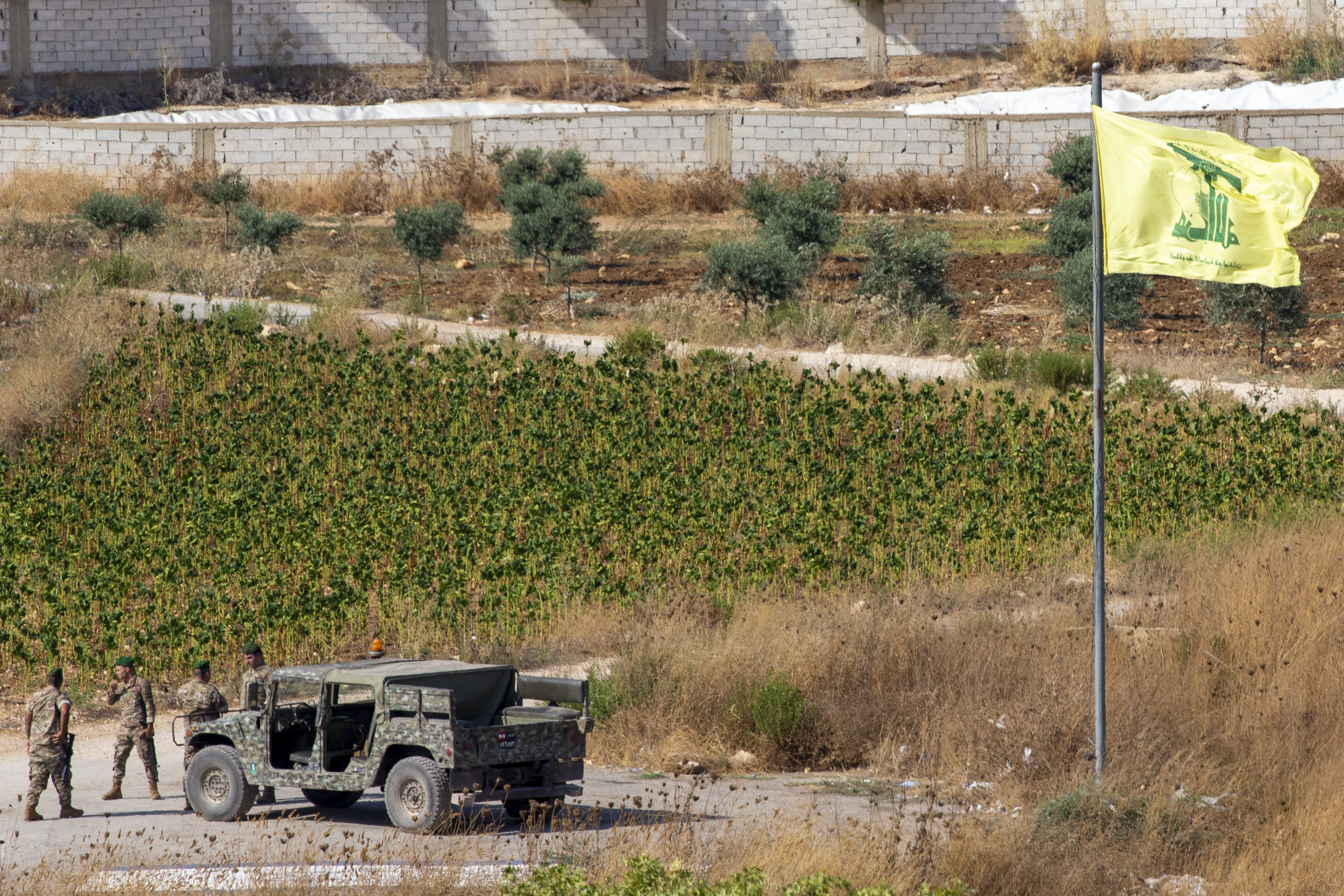 The Latest: Lebanese army fires at 2 Israeli drones