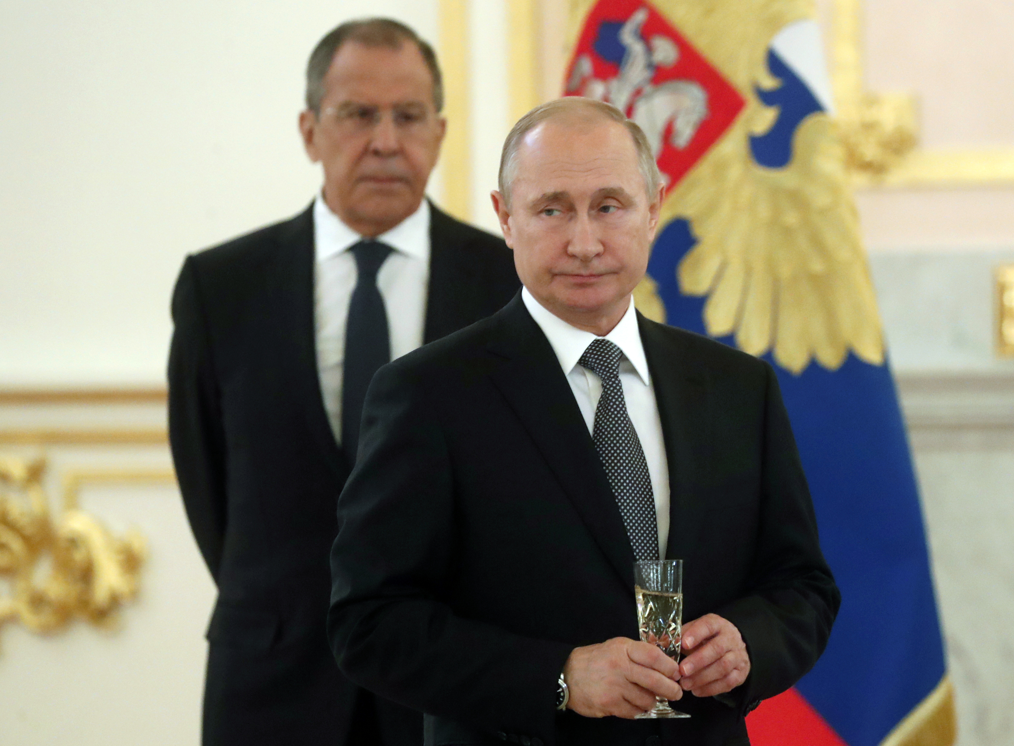 Putin signs bill suspending participation in nuclear treaty