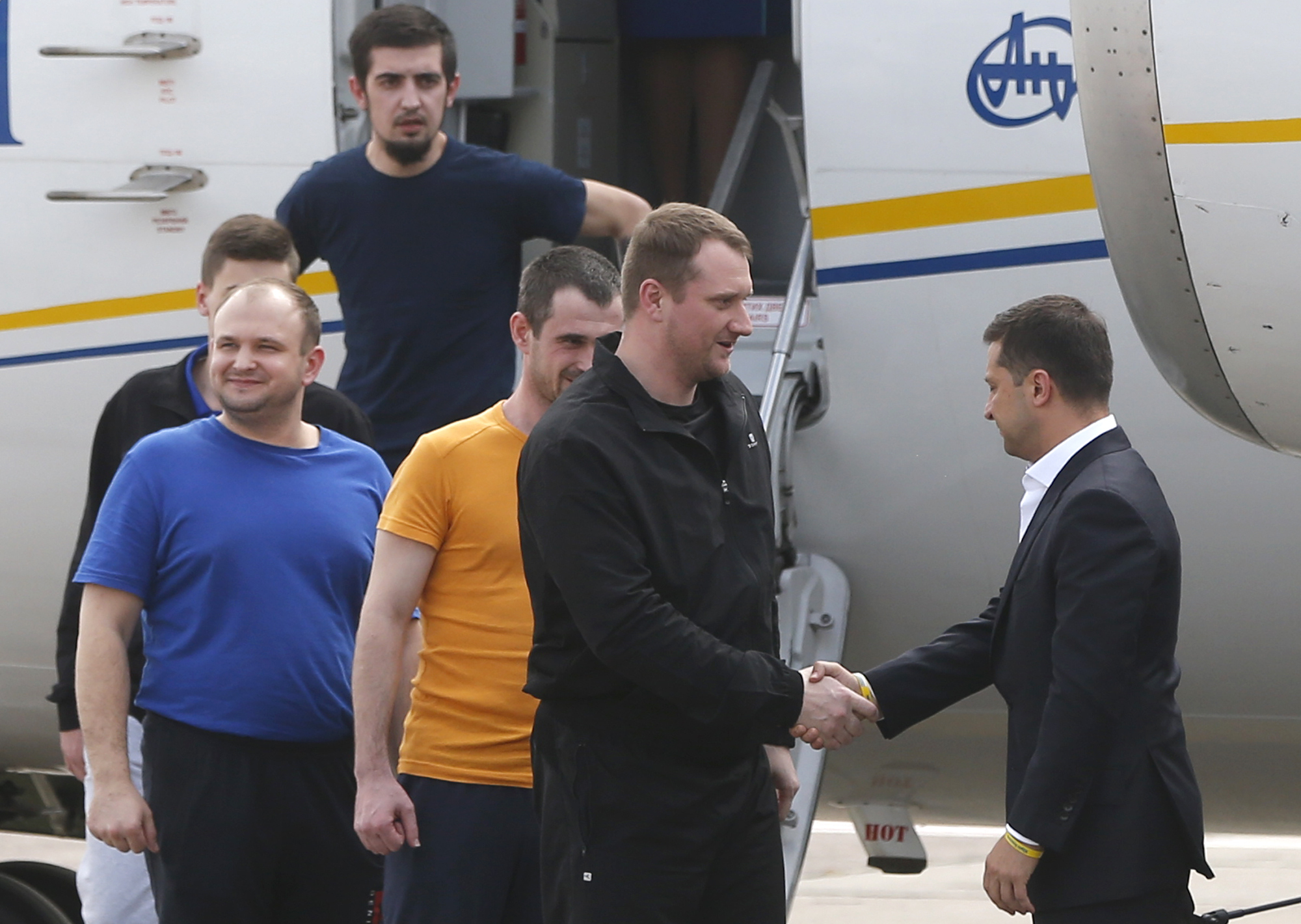 The Latest: Ukraine leader greets prisoners freed by Russia